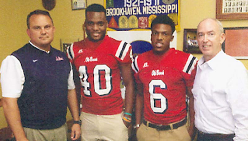 DAILY LEADER / Photo Submitted / Brookhaven head football coach Tommy Clopton was a guest speaker for the Brookhaven Servitium Club meeting Wednesday at Poppa's Fish House. Pictured with Clopton (left) are Dandy Dozen player Leo Lewis (40), running back Trey McDaniel (6) and club president Shannon Aker.