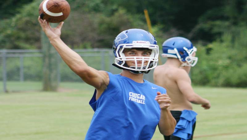 DAILY LEADER / MARTY ALBRIGHT / Brookhaven Academy quarterback Heath Hickman works on  passing drills Thursday.
