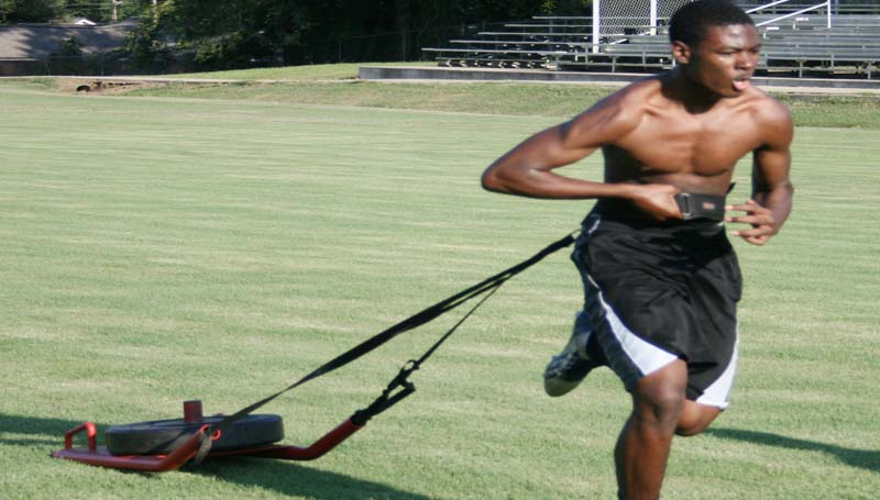 DAILY LEADER / MARTY ALBRIGHT / Bogue Chitto's Sherman Jackson works on his conditioning and speed while pulling a weighted sled.