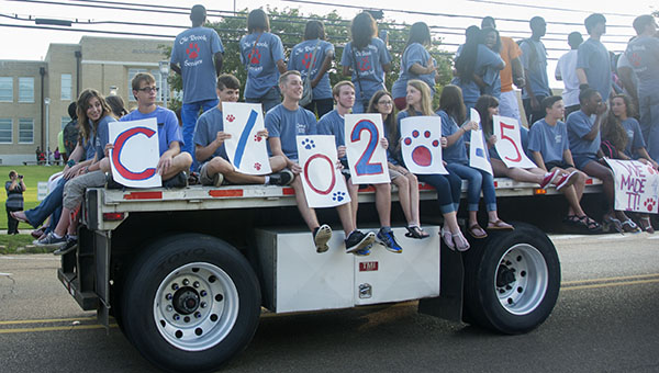 DAILY LEADER / KATIE WILLIAMSON / Brookhaven High School seniors ride to the first day of school on the flatbed of an 18-wheeler early Thursday morning.