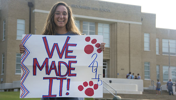 DAILY LEADER / KATIE WILLIAMSON / Senior Madie Currie holds up her sign in front of Brookhaven High School on the first day of school early Thursday.