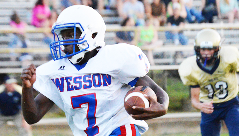 Wesson sophomore Jermaine James (7) speeds up the field Friday. He led his team in rushing and had one fumble recovery during the jamboree.
