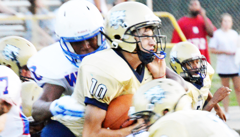 DAILY LEADER /T RACY FISCHER /  Bogue Chitto quarterback Tucker Lambert (10) is stopped by Wesson's Jermaine James (7)and Kendrick Brown (20) during Friday's jamboree.