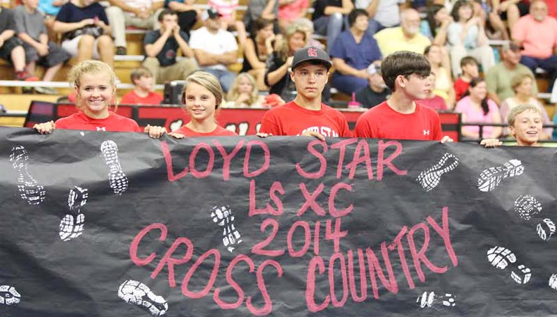 DAILY LEADER / Photos by AMY RHOADS / Loyd Star Attendance Center hosts Meet The Hornets Tuesday night. Friends and families gather to show their support and provide excitement before the Hornets begin their football season Friday night at 7:30 against Bogue Chitto (left photo). In the top photo, Loyd Star introduces their new cross-country team. This is the first year the school will be offering the sport. The Hornets cross-country team will participate in their first race Saturday at the Brookhaven Downtown Meet, beginning at 7:30 a.m.