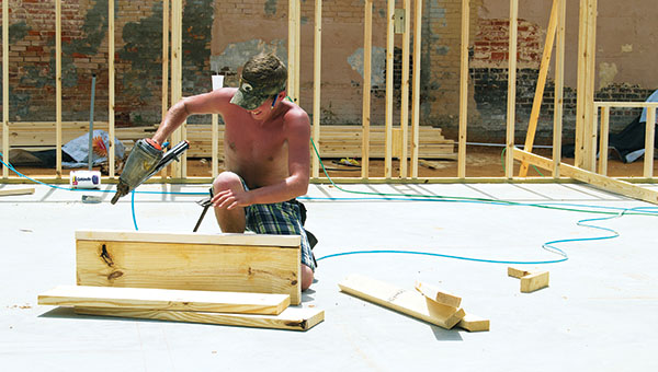 DAILY LEADER / RACHEL EIDE / Meanwhile, Martin Lindsey, also with DWD, works on another part of the project. DWD is in charge of the framing portion of the building, and work was moving quickly with all four wall frames up by Thursday morning.