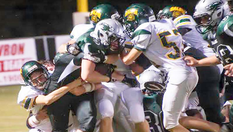 DAILY LEADER / TERESA ALLRED / West Lincoln's Bryce Temple (5) fights through a host of Salem players to gain some yards Friday night at Perry Miller Field.