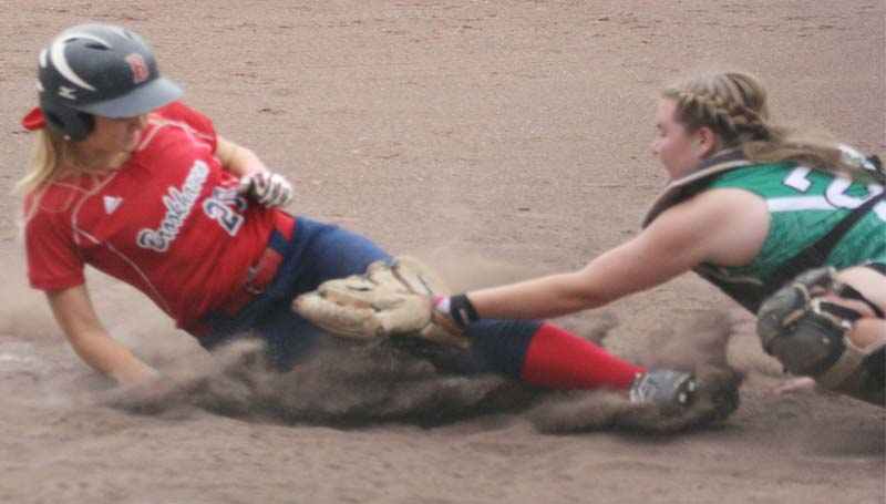 DAILY LEADER / MARTY ALBRIGHT / Brookhaven's Haley Speak slides safely under the tag of West Lincoln catcher Anna Brooke Davis at home plate in slowpitch softball action at the Lady Panthers Softball Complex.