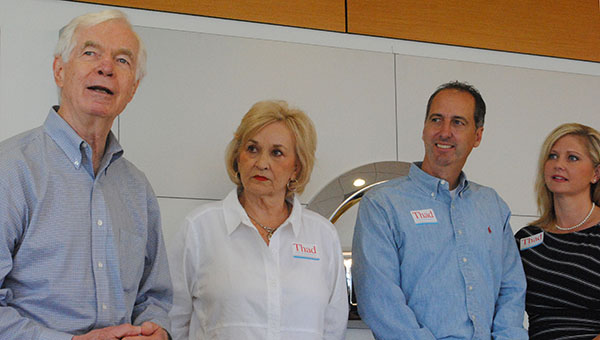DAILY LEADER / JULIA V. PENDLY / Thad Cochran (left) addressed a crowd of supporters at Paul Barnett Nissan Tuesday. He thanked Lincoln County for their support over the years and asked for continued support. Karen Sullivan (from left), Paul and Jennifer Barnett listen to Cochran.