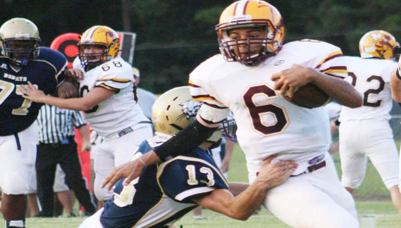 DAILY LEADER / MARTY ALBRIGHT / Enterprise's Chance Lacking (6) tries to get away from Bogue Chitto tackler Kobe Roberts (13) in Thursday night's football action.