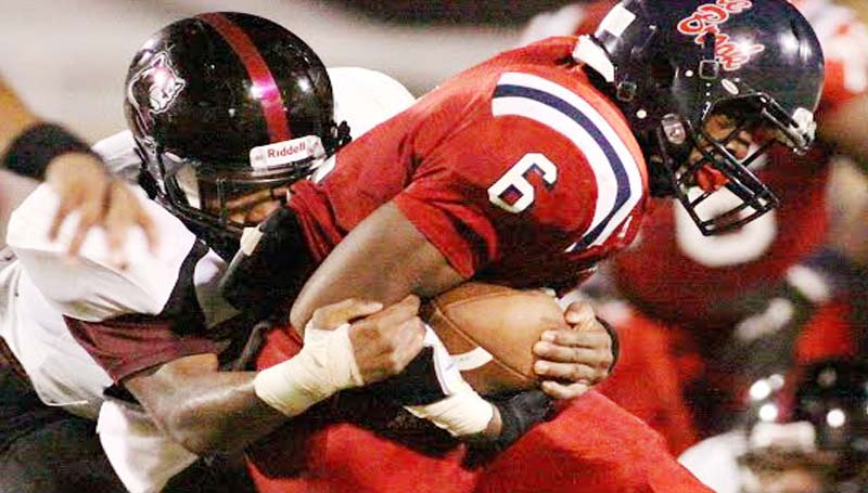 DAILY LEADER / JONATHON ALFORD / Brookhaven running back Tre McDaniel (6) holds on to the ball as Lawrence County defender T-Tex Cole bring him down.