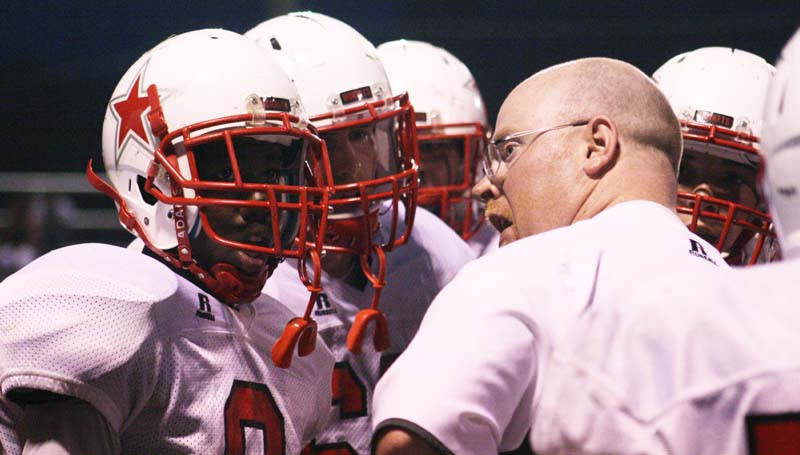 DAILY LEADER / MARTY ALBRIGHT / Loyd Star coach Adam Cook talks to his players during a timeout Friday night.