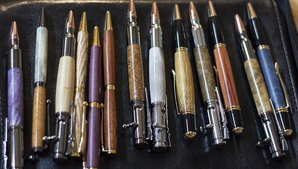 DAILY LEADER / KATIE WILLIAMSON / Rushing has crafted pens from a variety of materials, purple-heart wood to antler.