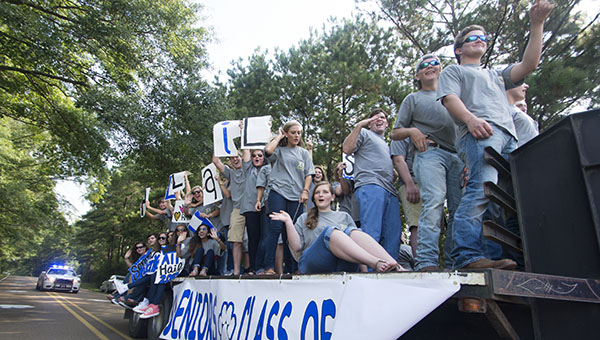 DAILY LEADER / KATIE WILLIAMSON / Brookhaven Academy seniors arrive to their first day of school Monday on a trailer. The students paraded through town with bright signs and loud music as they made their way to school.
