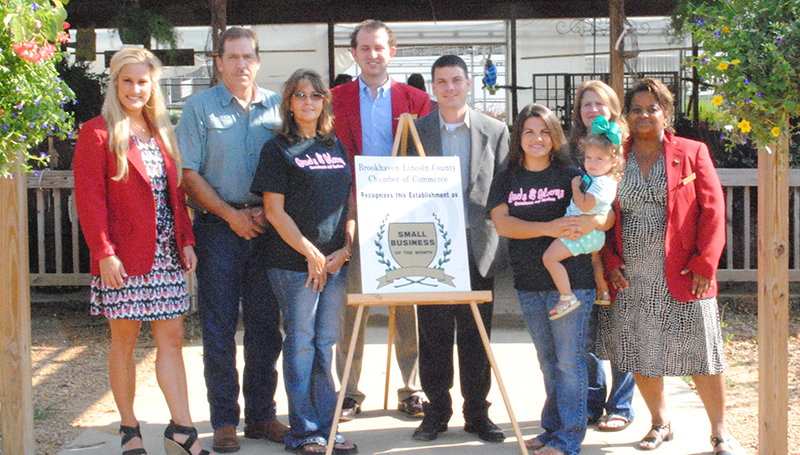 DAILY LEADER / LYNDY BERRYHILL / Buds and Blooms nursery, located on Highway 550 past Loyd Star Attendance Center, received the Brookhaven-Lincoln County Chamber of Commerce's Business of the Month Award for August. Pictured are (from left) Mary Catherine McDonnieal, Dusty Case, Donna Case, Jason Snider, Garrick Combs, Leah Case, Layla Case, Susan Jabour and Donna Foster.