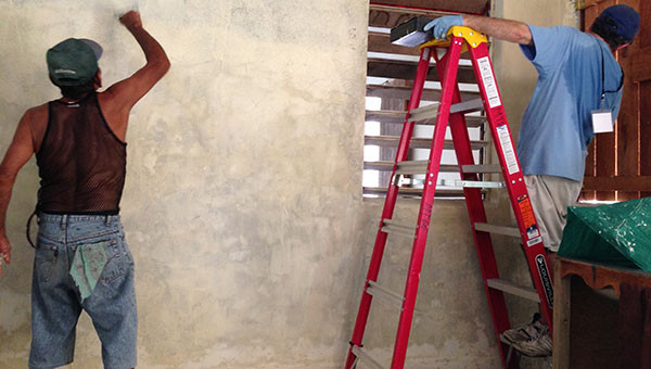 PHOTO SUBMITTED / Belize residents help Faith Presbyterian Church missionary volunteers repaint and renovate Shalom Church in Belize.