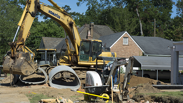 DAILY LEADER / KATIE WILLIAMSON / Work crews take over an area on West Chickasaw Street to replace drainage culverts Thursday. The project began two weeks ago and will most likely continue a few more weeks, according to Steve Moreton, director of public works for the city of Brookhaven. Workers will be inserting culverts and pouring concrete over bricks in the drainage tunnel across the street. Moreton said there are no other similar projects planned.