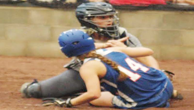 DAILY LEADER / TRACY FISCHER / Bogue Chitto catcher Reagan Kirkland (15) tags out Wesson's Kayla Britt (14) sliding into home plate Thursday night.