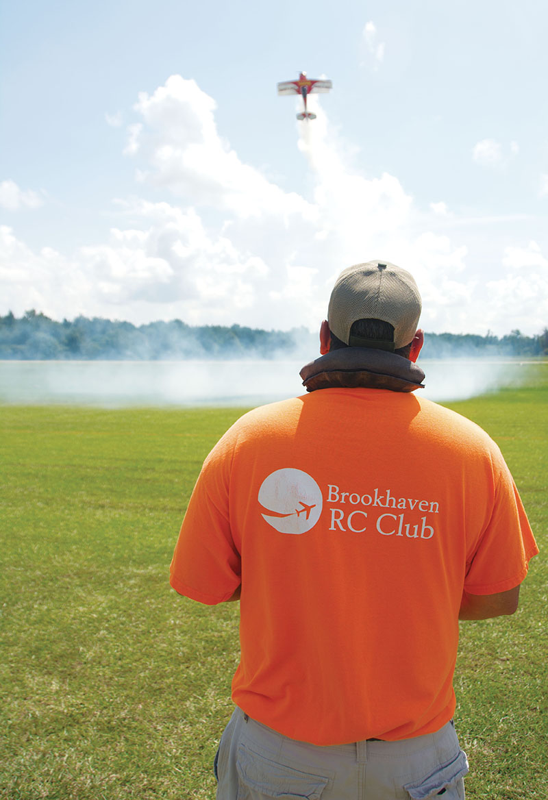 David Dussetschleger, president of the Brookhaven RC Club, flies his radio-controlled plane Saturday at the Brookhaven Airport. His Pitts Model 12 is 47 percent of the size of the actual plane with a 111 inches wingspan.