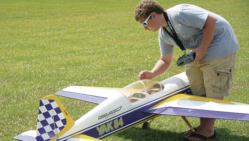 DAILY LEADER / KATIE WILLIAMSON / Casey Koehler, 15, of Summit turns off his Yak 54 airplane after its flight Saturday.