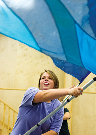 DAILY LEADER / KATIE WILLIAMSON / Kerri Newell, 16,  twirls her flag during Loyd Star color guard practice Tuesday.