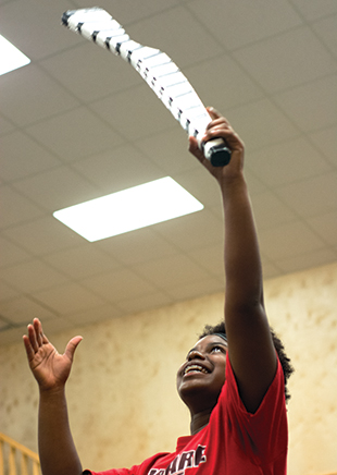DAILY LEADER / KATIE WILLIAMSON / Lanora Lundy, 17,  throws a wooden rifle in the air during the practice session.