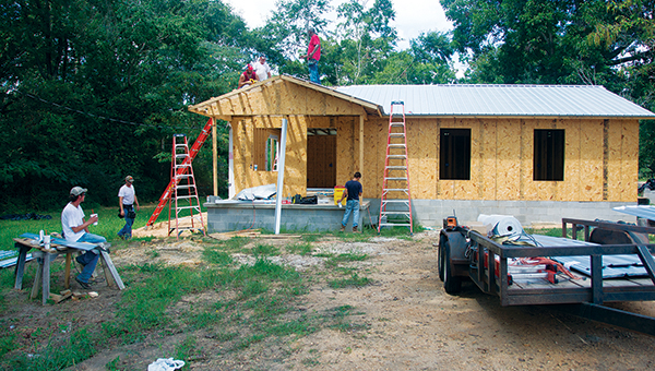 DAILY LEADER / KATIE WILLIAMSON / The habitat for humanity house on the corner of Choctaw and Dr. Martin L. King Jr. gets a roof Thursday.