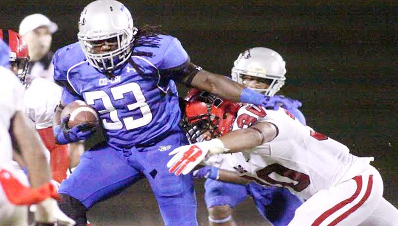 DAILY LEADER / JONATHON ALFORD / Co-Lin's sophomore running back Joshua Bates (33) uses his break away speed to deny Ms. Delta's defender Alex Johnson (30) a tackle Thursday night in JUCO action at Stone Stadium.