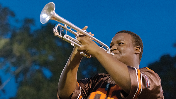 DAILY LEADER / KATIE WILLIAMSON / Rajavion Makabee plays a trumpet solo during Brookhaven High School marching band practice Thursday evening.