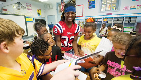 DAILY LEADER/ KATIE WILLIAMSON / Ken Boyd signs autographs for Brookhaven Elementary School teacher Samantha Rushing's third-grade class during the read like a champion event Friday.