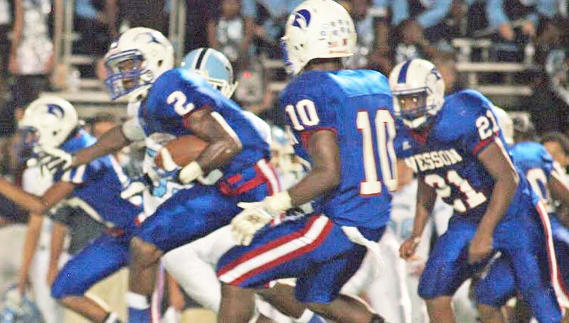 DAILY LEADER / TRACY FISCHER / Wesson's Michael Hauer (2) breaks through North Pike's defense to a positive gain as teammates Jeremiah Stapleton (10) and Demarcus Smith (21) looks on Friday night.