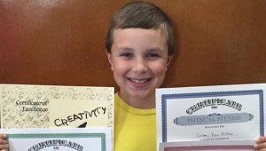Photo Submitted Zachery McGehee shows off his awards after BES's awards ceremony in May, where it was announced that he had made the second-highest reading score in the state on the third grade reading gate.