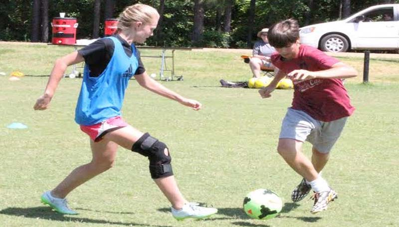 CO-LIN MEDIA / CLIFF FURR / Kelsi Barron of Magnolia attempts to take the ball away from Kyle McCormick of Meadville on Wednesday at Co-Lin soccer camp. The camp ran from Monday until Wednesday and saw more than 30 area athletes participate.