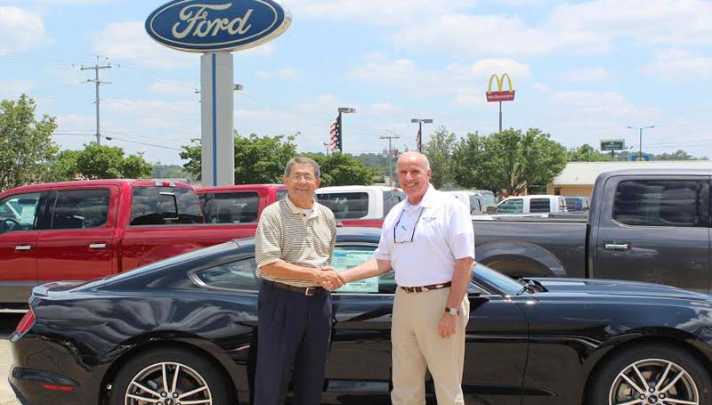 CO-LIN MEDIA / Photo Submitted / HOLE IN ONE PRIZE - Doug McElveen (right), sales manager of Sullivan Ford Lincoln in Brookhaven, hands over the keys to a 24-month lease on a 2015 Ford Mustang to Copiah-Lincoln Community College Foundation Board member Bradley Smith to be used as grand prize for making a hole in one on number 11 during the Co-Lin Foundation Golf Classic June 18. The tournament is held at Wolf Hollow Golf Course on the Wesson campus and supports programs of Copiah-Lincoln Community College. For information on playing or sponsoring the tournament, contact David Campbell at (601) 643-8332.