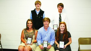 The Brookhaven Academy tennis team was honored during their school's athletic banquet. Players receiving awards were (seated, from left) Marlee Watts, Most Valuable Girl; Trent Nettles, Most Valuable Boy; Susanne Ratcliff, Cougar Award; (standing) Dylan Winborne, Rookie of the Year; Jacob Wiggins, Cougar Award.