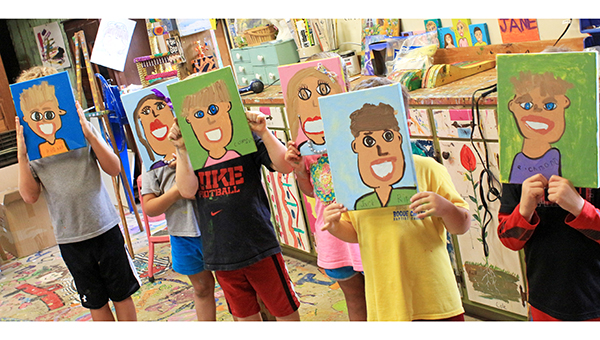 April Garon / Benton Byrd, Brooke Thaxton, Carson Cunningham, Emmy Franis, Jack Rippy, Richmond Froelecker hold the self-portraits they painted at Ava Jane Newell's Art Barn. Newell is hosting a summer art camp through July.