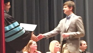 Reid Roberson picks up his certificate at the end of Governor's School. Roberson, a rising senior, also attended Boys State this summer.