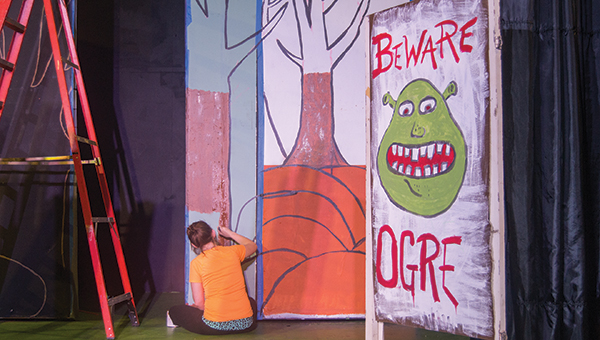 """Photo by Nathaniel Weathersby Jessica Redd paints a tree on the BLT stage in preparation for the BLTeens preparation of the """"Shrek Jr."""" Redd got involved with BLTeens in high school. Now, at 21, she has come back to help out with the month-long prep and production."""