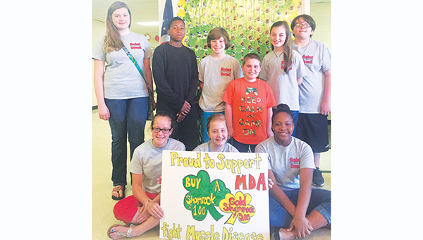 Photo submitted The Lipsey School student council stands behind Nathan Williamson (in orange) with their support of the Muscular Dystrophy Association through the shamrock campaign. The student council raised approximately $500 to send kids like Williamson with MD to a summer camp at no cost to camper's families.