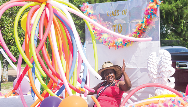 Photos by Nathaniel Weathersby Emma Watkins Cook waves from the Class of 70 float during the Eva Hall Harris Lincoln County Schools Reunion Parade. The parade was part of the schools' 10th reunion.