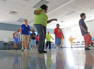 Dancers move to the beat during line dancing class at the Jimmy Furlow Senior Citizen Center. The center offers classes in line dancing for beginners and adults.