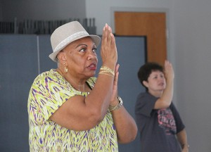 """Jackie Abrams does sign language while line dancing to the song """"God is Good."""" The line dancers say """"Good is good, all the time"""", the lyrics of the song, in sign language while they dance."""