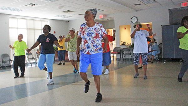 April Garon / The line dancers dancing at the Jimmy Furlow Senior Citizens Center.