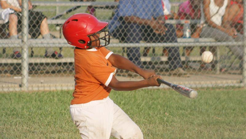 DAILY LEADER / Corey Smith collects a hit for Smith 84E Carwash.