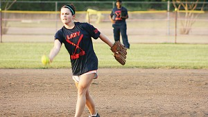Brookhaven's pitcher Peyton Beale delivers her pitch in Ole Brook's Alumni softball tournament.