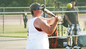 Ashley Fauver provides Loyd Star with a hit in Ole Brook's Alumni softball tournament.