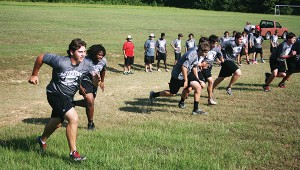 Loyd Star's linemen work on endurance during during Loyd Star's summer workout.