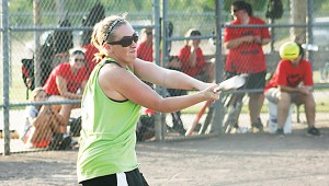 Emily Davis provides West Lincoln with a hit in Ole Brook's Alumni softball tournament.