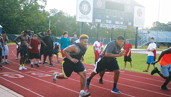 Photos by MARTY ALBRIGHT Brookhaven's linemen work on their speed in an early morning workout on the track recently.