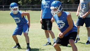 Brookhaven Academy's Connor Griffin (left) and Price King (right) works on some skill drills during football practice Friday.