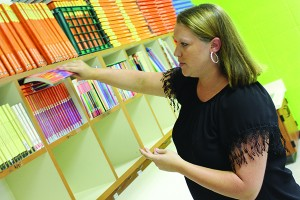 Ronnye Hart, who teaches third grade at Bogue Chitto Attendance Center, arranges the bookshelf in her classroom. Teachers across the county are preparing for the school year to begin .